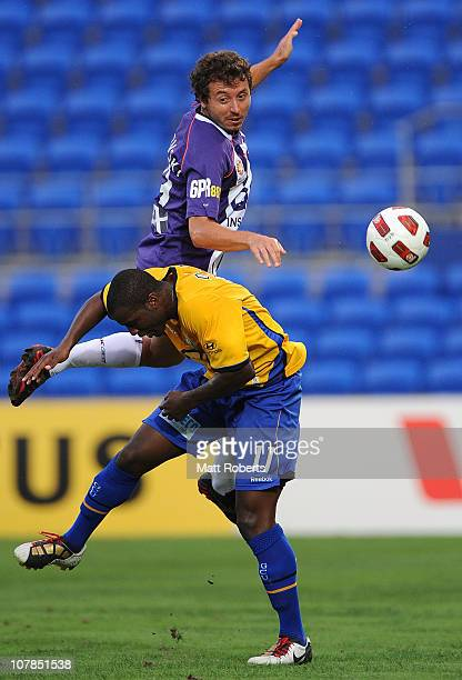 Naum Sekulovski of the Glory heads the ball over Bruce Djite of Gold Coast during the round 21 ALeague match between Gold Coast United and the Perth...