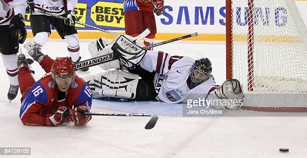 Nauris Enkuzens of Latvia and the player of the game for Latvia stretches out to stop a shot from Sergei Andronov of Russia at the Civic Centre on...