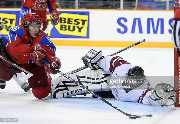 Nauris Enkuzens of Latvia stretches out to stop a shot from Sergei Andronov of Russia at the Civic Centre on December 26, 2008 in Ottawa, Ontario,...