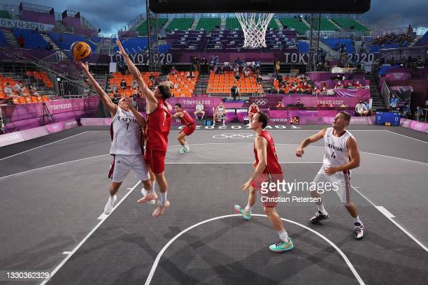 Nauris Miezis of Team Latvia drives to the basket during the Men's Pool Round match between Latvia and Belgium on day one of the Tokyo 2020 Olympic...