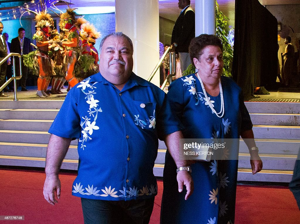 Nauru President Baron Waqa (L) arrives for the official opening of the 46th Pacific Islands Forum (PIF) in Port Moresby on September 8, 2015. The 16-nation grouping consists mainly of small island nations, together with Australia and New Zealand, with the two developed nations being accused of dragging their feet on climate change. AFP PHOTO/Ness KERTON