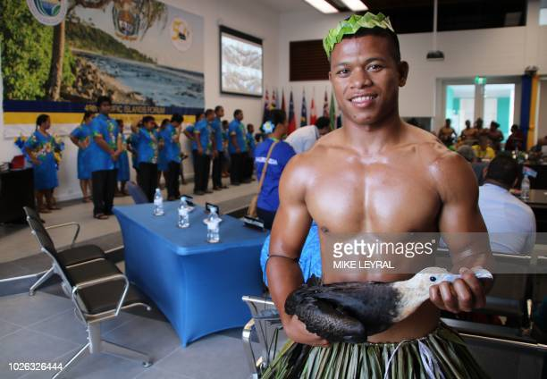 A Nauruan man holds a symbolic bird before being presented to leaders attending the Small Islands States meeting ahead of the start of the Pacific...