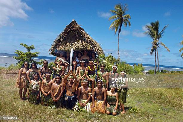 Nauruans dress in traditional Pacific island costumes to welcome the Melbourne 2006 Queen's Baton during the Nauru leg of the baton's journey...