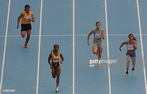 Nauru's Lovelite Detenamo Jamaica's ShellyAnn FraserPrice Kazakhstan's Olga Bludova and Brazil's Ana Claudia Silva compete in the women's 100 metres...