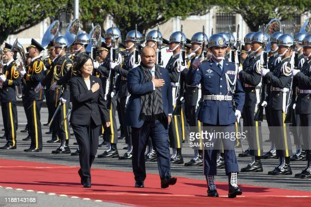 Nauru's President Lionel Aingimea and Taiwan's President Tsai Ingwen inspect an honour guard during a welcome ceremony outside the Presidential...