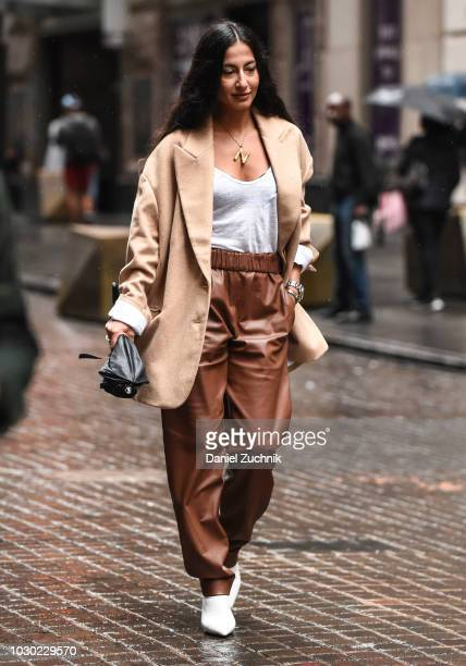 Nausheen Shah is seen wearing a brown coat white top and brown leather pants outside the Tibi show during New York Fashion Week Women's S/S 2019 on...