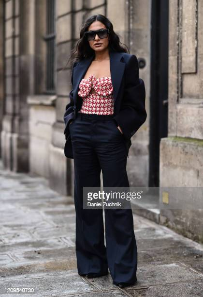 Nausheen Shah is seen wearing a navy blue suit and red and white top outside the Altuzarra show during Paris Fashion Week: AW20 on February 29, 2020...