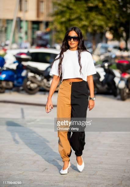 Nausheen Shah is seen wearing beige black two tone pants outside the Alberta Ferretti show during Milan Fashion Week Spring/Summer 2020 on September...