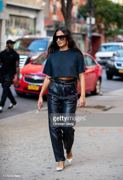 Nausheen Shah is seen wearing navy cropped top black leather pants outside Dion Lee during New York Fashion Week September 2019 on September 11 2019...