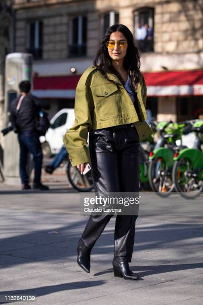 Nausheen Shah wearing a military green cropped jacket black leather pants black boots and yellow sunglasses is seen outside Mugler on Day 3 Paris...