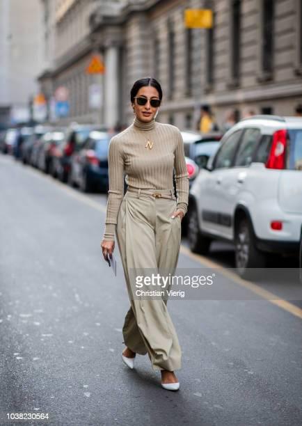 Nausheen Shah wearing beige wide leg pants turtleneck is seen outside Salvatore Ferragamo during Milan Fashion Week Spring/Summer 2019 on September...
