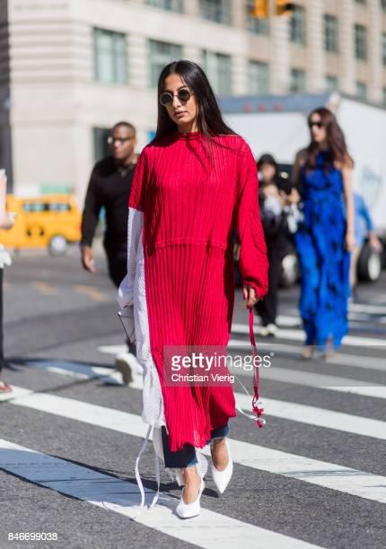 Nausheen Shah wearing red white dress seen in the streets of Manhattan outside Michael Kors during New York Fashion Week on September 13 2017 in New...