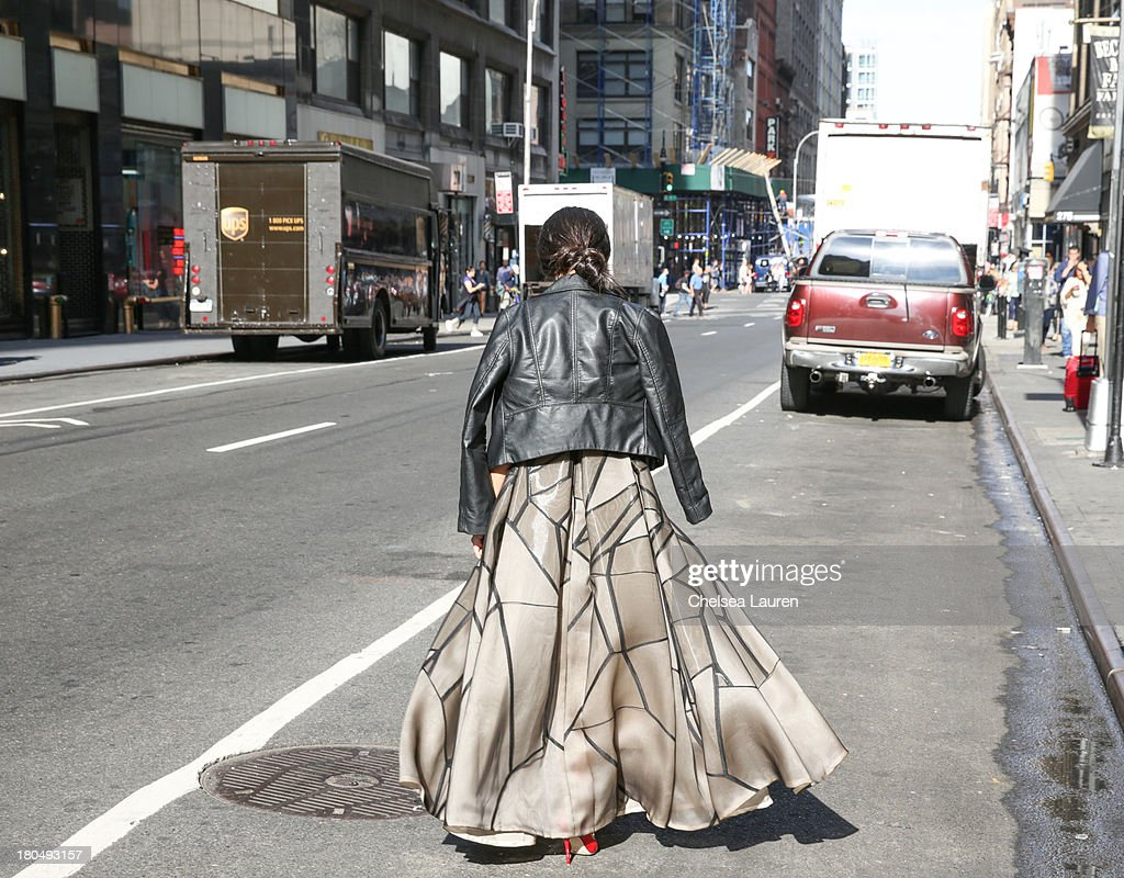 LOOK #18. Nausheen Shah, writer and stylist working with MarieClaire.com and the New York Post, wears a Bibhu Mohapatra Spring 2014 onyx fracture organza jacquard dress with inverted pleats, with a vintage leather jacket and Jimmy Choo shoes on the streets of Manhattan's garment district on September 13, 2013 in New York City.