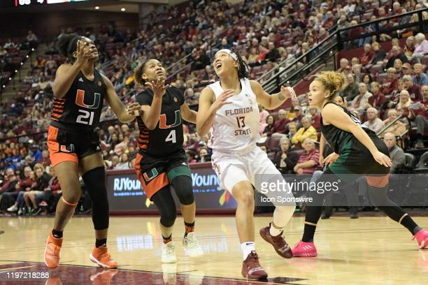 Nausia Woolfolk guard Florida State University Seminoles is surrounded by Brianna Jackson forward Endia Banks guard and Kenza Salgues guard...