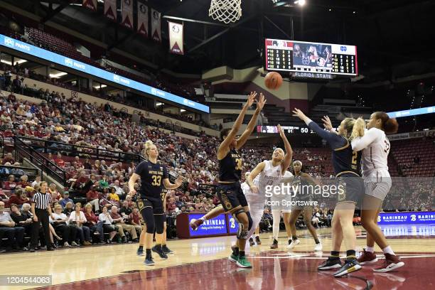 Nausia Woolfolk guard Florida State University Seminoles lofts the basketball in traffic against the Notre Dame Fighting Irish Sunday March 1 at the...