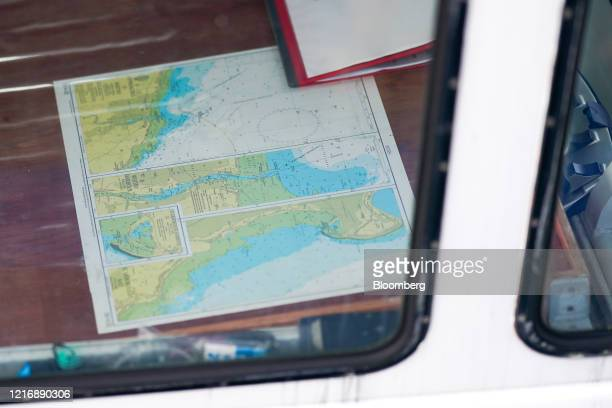 A nautical chart of Whitby Harbour sits in the wheel house of a fishing boat in the harbour in Scarborough UK on Tuesday June 2 2020 The threat of a...