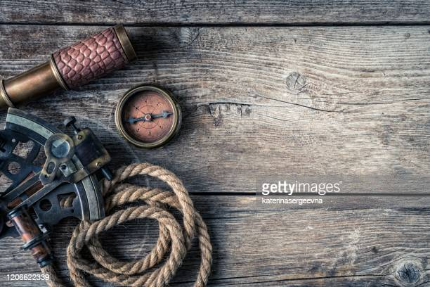 nautical equipment on the wooden background, high above - compass rose stock pictures, royalty-free photos & images