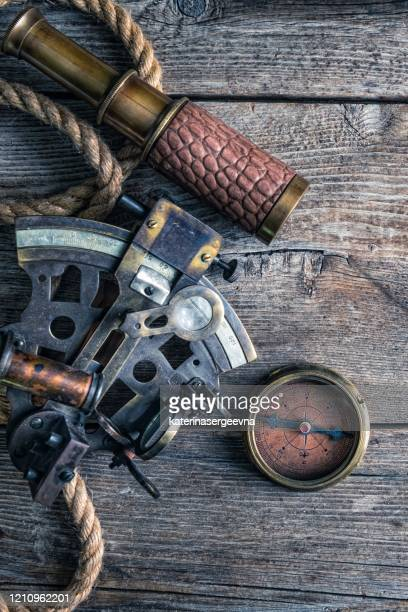 nautical equipment on the wooden background - compass rose stock pictures, royalty-free photos & images