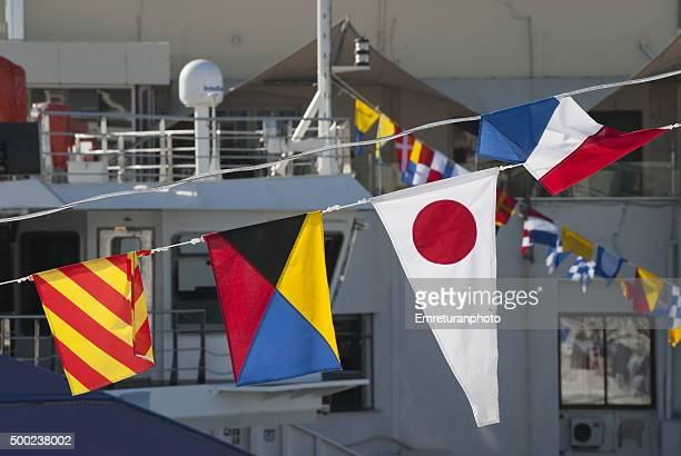 nautical signal flags on a passenger ferry - emreturanphoto stock-fotos und bilder