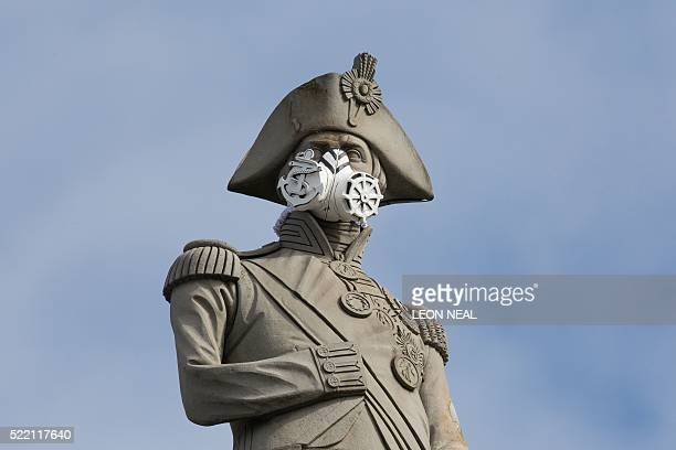 A nautical themed breathing mask is fixed to Lord Nelson's statue at the top of Nelson's Column in Trafalgar Square central London on 18 April 2016...