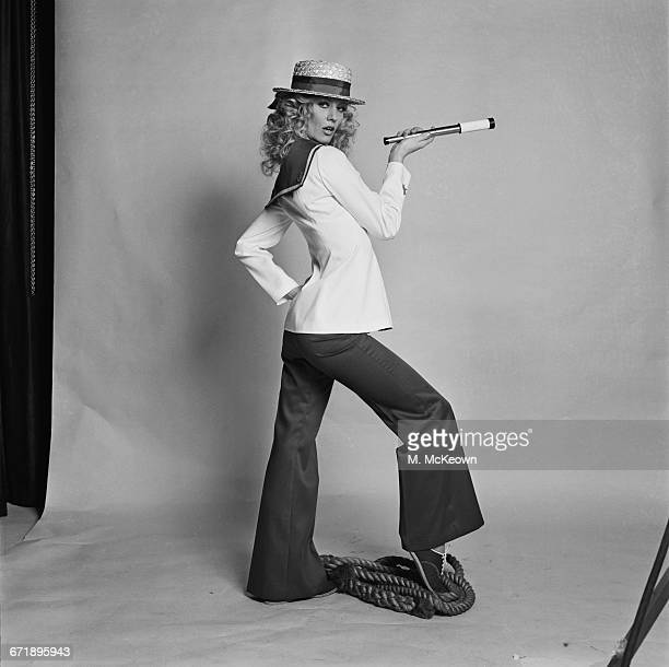 A nautical trouser suit modelled by English actress and model Vicki Hodge UK 20th October 1971