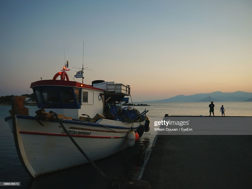 Nautical Vessel Moored By Pier On Lake During Sunset : Stock Photo