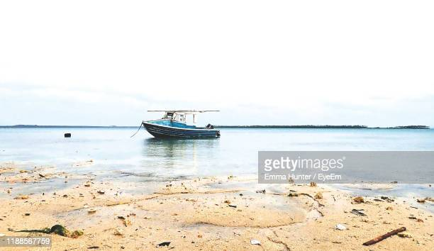 nautical vessel on sea against sky - emma hunter eye em stock photos and pictures