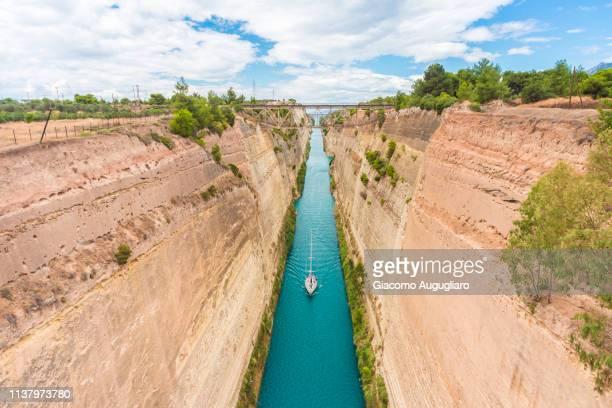 nautical vessel sailing through the corinth canal, corinthia region, greece, europe - kanal stock-fotos und bilder