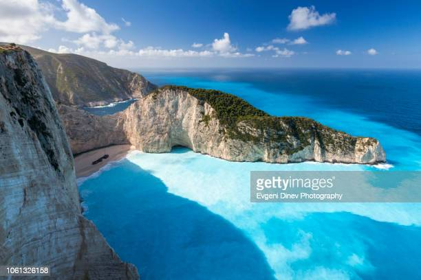 navagio bay, zakynthos, greece - shipwreck beach - midday stock pictures, royalty-free photos & images