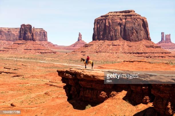Navaho Indian on horse in Monument Valley, Arizona, USA
