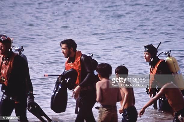 Navajo boys watch a scuba diving class at Lake Powell Image courtesy National Archives Arizona 1973