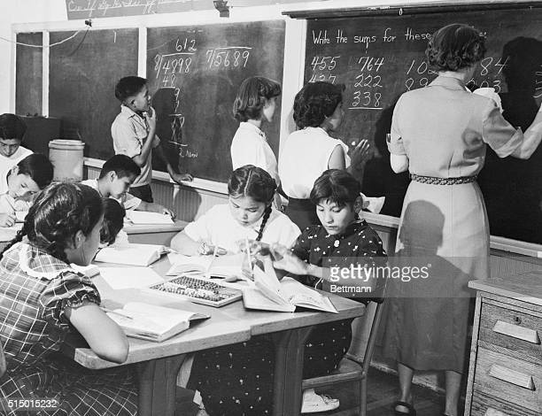 Navajo children learn arithmetic at a governmentrun school on the Navajo Indian Reservation