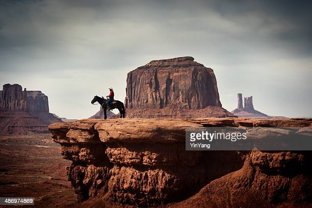 navajo cowboy in american southwest landscape - southwest usa stock pictures, royalty-free photos & images