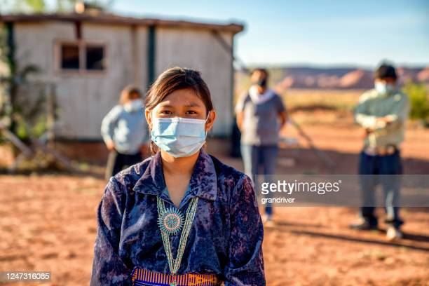 navajo family social distancing with covid-19 masks outside their home in monument valley arizonaa - india imagens e fotografias de stock