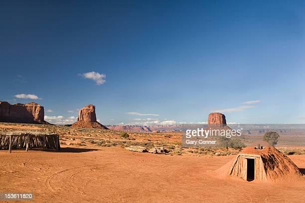 navajo hogan and ramada at monument valley - navajo hogan stock photos and pictures