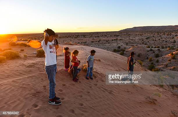 Navajo Indians Alden Begay left and family members Amanda Begay second Karleah Angeles third Arlen Begay and Arlo Begay far right take a walk on...