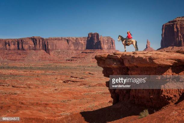 navajo man on horse at john ford's point monument valley - monument valley tribal park stock photos and pictures