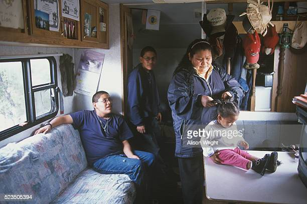 Navajo Mother and Children Living in Small Mobile Home