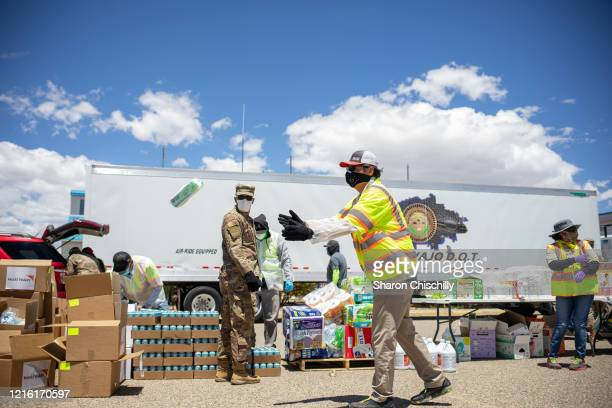 Navajo Nation President Jonathan Nez helps distribute food, water, and other supplies to Navajo families on May 27, 2020 in Huerfano on the Navajo...