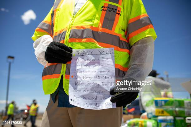 Navajo Nation President Jonathan Nez holds a letter from a Navajo family while distributing food, water, and other supplies on May 27, 2020 in...