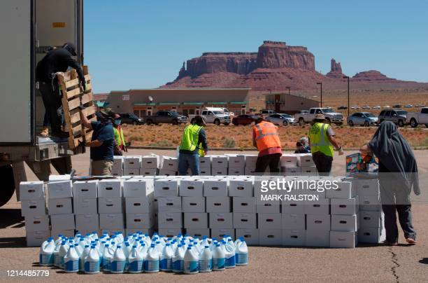 Navajo Nation volunteers prepare food boxes for distribution to families in need outside Monument Valley Tribal Park, which has been closed due to...
