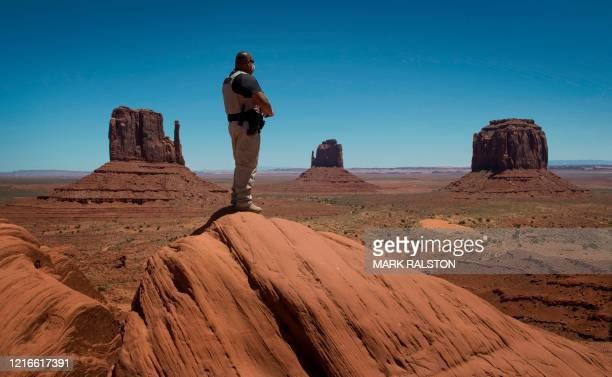 Navajo park ranger looks out over Navajo Nation-managed Monument Valley Tribal Park, which has been closed due to the Covid-19 pandemic in Arizona on...
