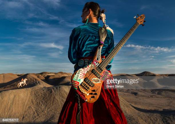 Navajo Punk rock band Sihasin is seen with their horse Moonshadow in a canyon in Cameron Arizona Sihasin comes from a long tradition of protest music...