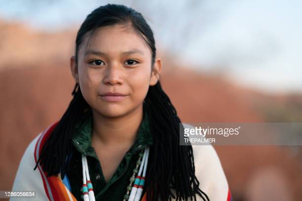 navajo teenager portrait wearing traditional clothes and jewerly - minority groups stock pictures, royalty-free photos & images