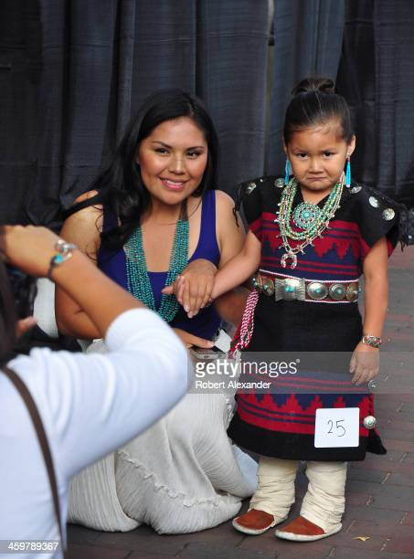 Navajo woman poses with her daughter a contestant in the Native American Clothing Contest at the annual Santa Fe Indian Market in Santa Fe New Mexico...