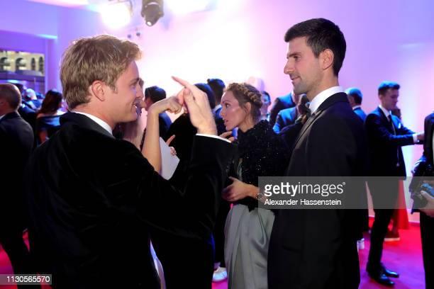 Navak Djokovic speaks with Nico Rosberg during the Red Carpet for the 2019 Laureus World Sports Awards on February 18 2019 in Monaco Monaco