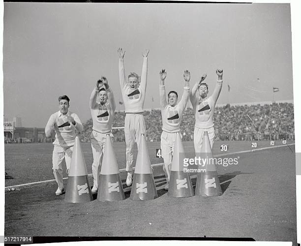 Naval Academy cheer leaders lead the student body during the annual ArmyNavy game in the Municipal Stadium here Navy won 14 to 6 left to right are...