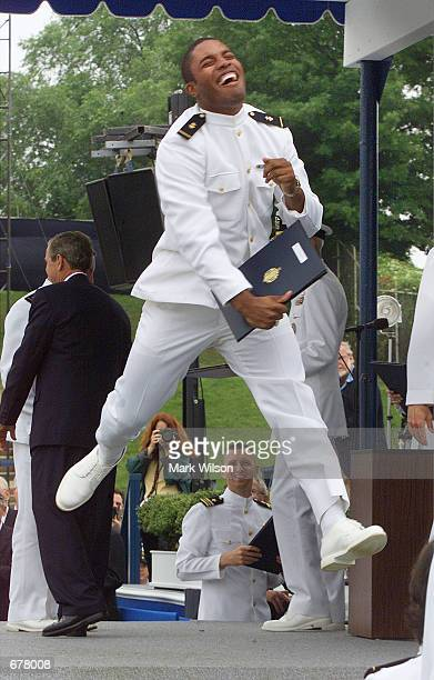 Naval Academy graduate Kevin Terrel jumps in the air after receiving his diploma from President George W Bush May 25 2001 in Annapolis MD The...