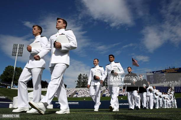 S Naval Academy graduates begin their procession into NavyMarine Corps Memorial Stadium during graduation ceremonies at the US Naval Academy May 26...