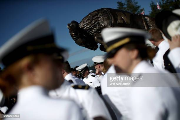 S Naval Academy graduates gather around a statue of the school's mascot before beginning their procession into NavyMarine Corps Memorial Stadium...